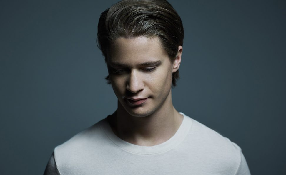 Musician Kygo looking downward.