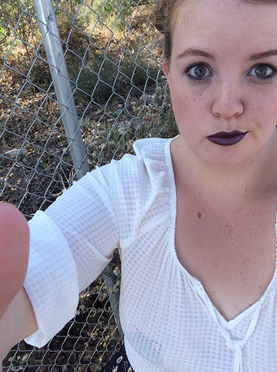 6522c81e8 I decided to wear the pasties as part of a '90s throwback look. I wore dark  purple lips, sunflower pants, and my old favorites: Doc Martins.