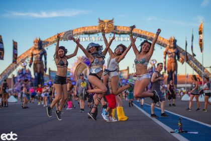 Women Unleash their Inner Goddess Under the Electric Sky