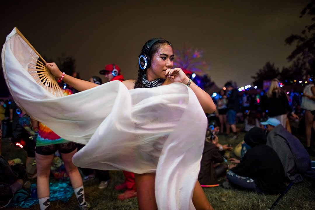 A Headliner dancing at the silent disco