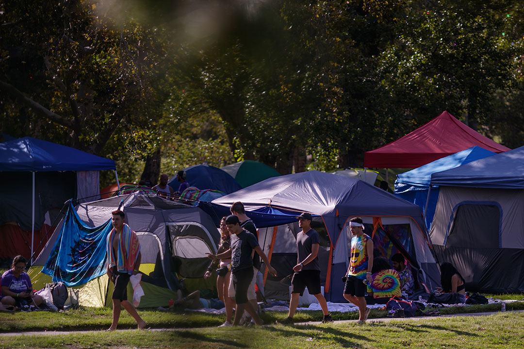 Campers walking past tents