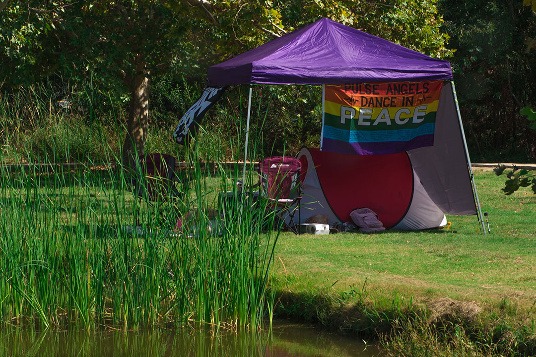 A tent with a commemorative Pulse flag