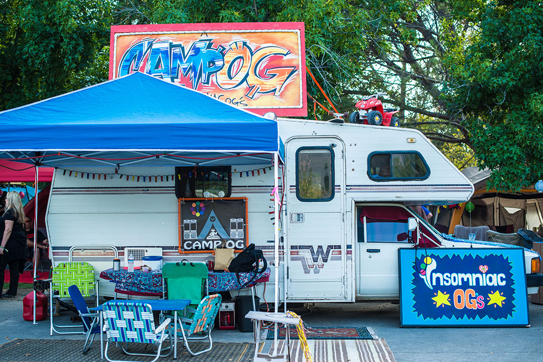 "An RV camp with a ""Camp OG"" sign"