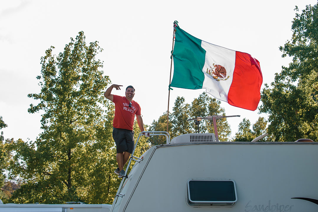 A Mexican flag over an RV