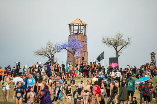 Headliners hanging out by the lighthouse