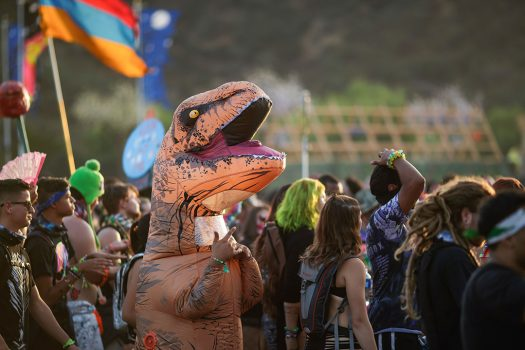 A Headliner in a dinosaur costume