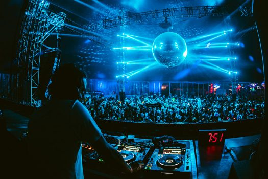 A disco ball shines during a DJ set