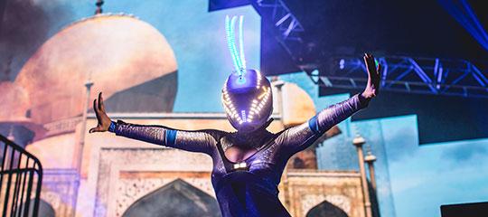 A futuristic performer in a helmet