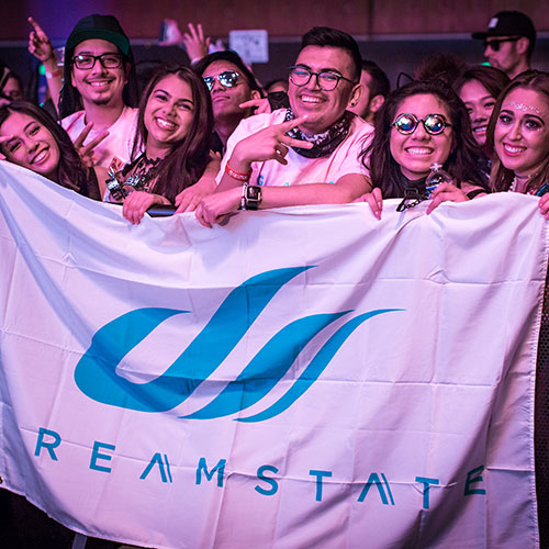 Headliners hold a Dreamstate flag