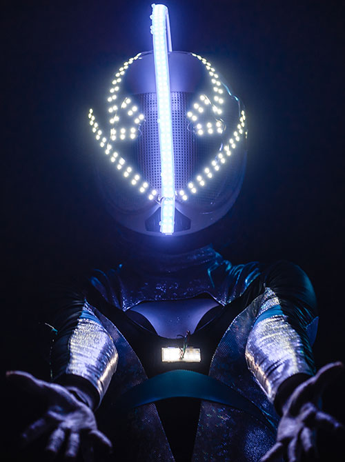 a futuristic performer welcomes you
