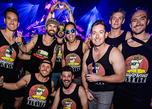 A group of smiling Headliners in matching tank tops