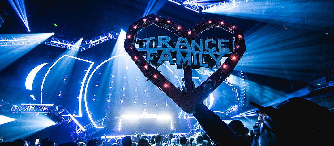 "A Headliner holds up a ""Trance Family"" totem"
