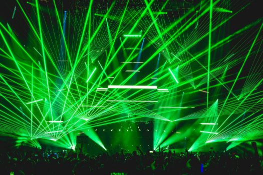 Green lasers beam from the stage