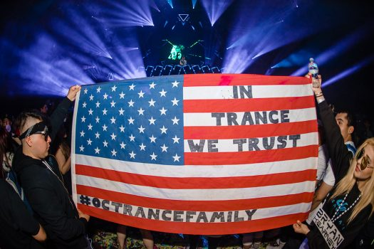 "Headliners with an ""In Trance We Trust"" flag"
