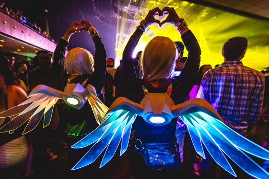 Two girls with glowing wings and heart hands