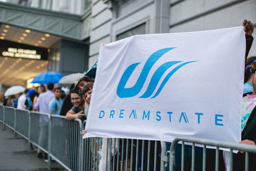 Headliners outside with a Dreamstate flag