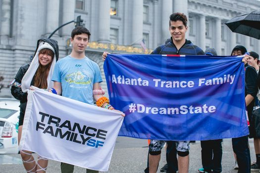 Headliners outside the venue with Trance Family flags