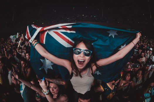 A Headliner with sunglasses and a flag