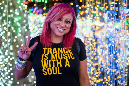 "A woman in a ""Trance Is Music With a Soul"" T-shirt"