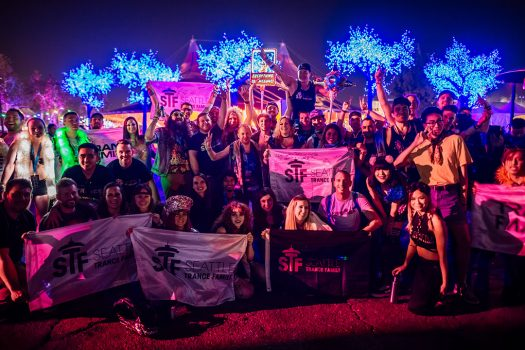 "A group of Headliners with ""Seattle Trance Family"" flags"