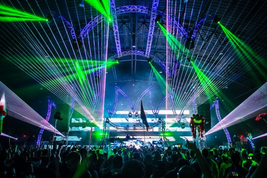 Lasers shoot from the stage