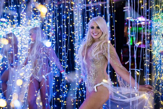 A woman in a glittery costume