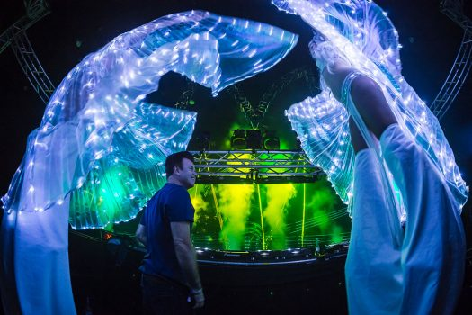Two costumed performers visit Paul Oakenfold