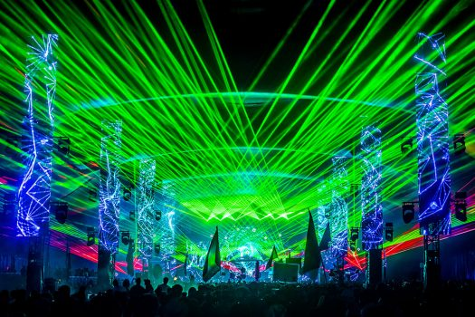 Lasers shoot out from the stage