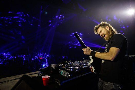 A DJ playing guitar