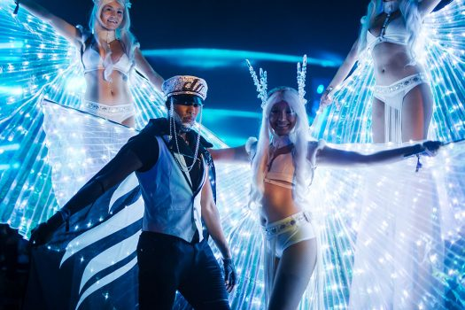 Performers with glowing wings