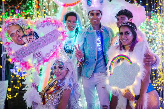 Headliners with glittery costumes and totems