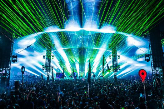 Green lasers shoot from the stage