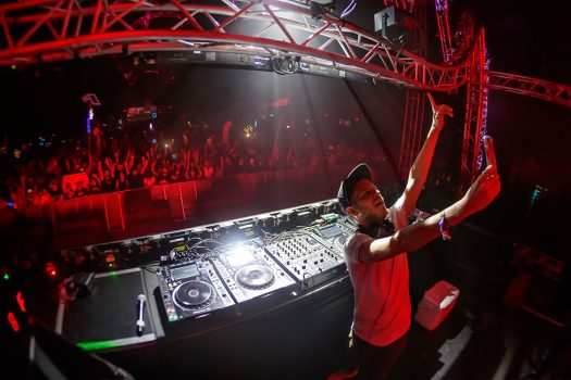 A DJ takes a selfie with the crowd