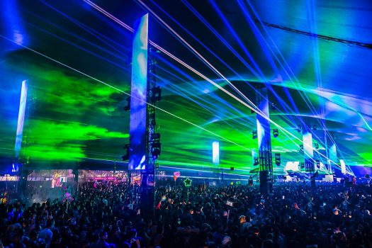Lasers beam out over the crowd