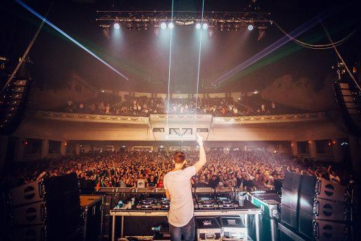 A DJ points upward
