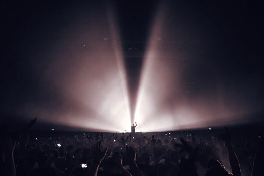 A DJ in silhouette