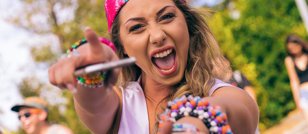 A girl with kandi and a phone