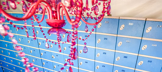 Red chandelier and blue lockers