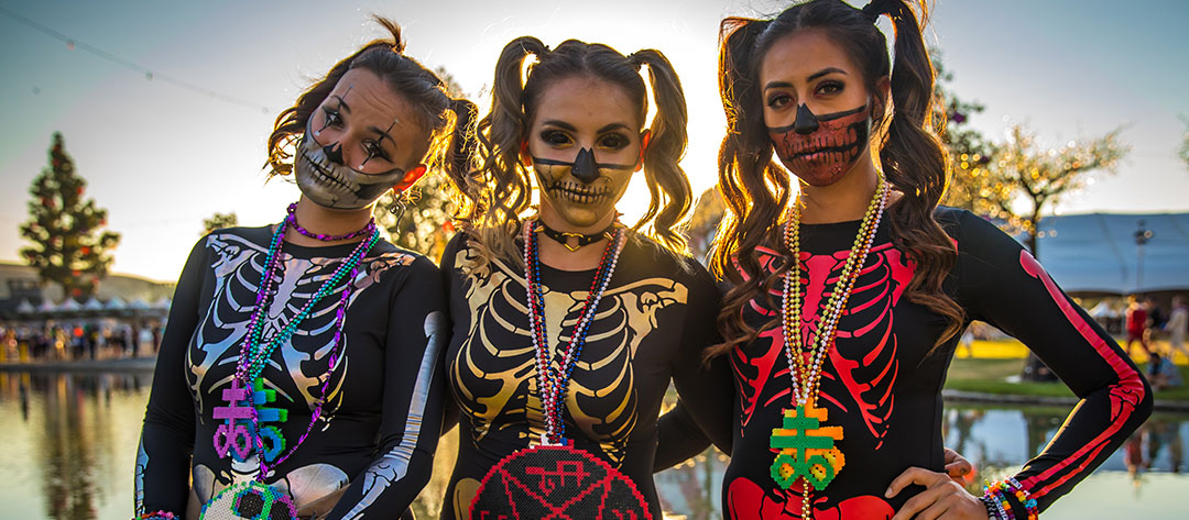 Three girls in skeleton costumes