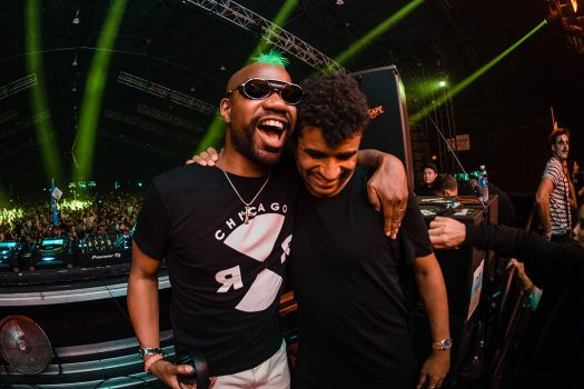 Two DJs hugging