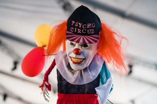 A creepy clown in a Psycho Circus hat
