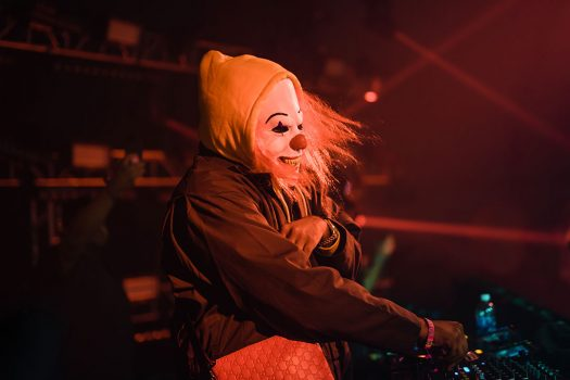 A DJ in a scary clown mask