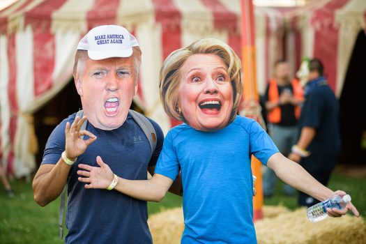 Headliners in Trump and Hillary masks
