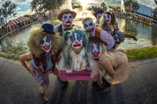 Performers in clown makeup