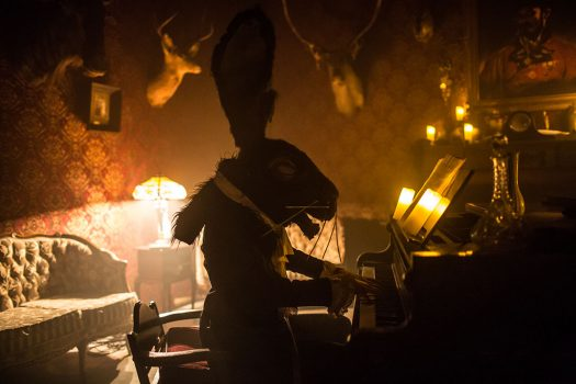 The March Hare plays the piano