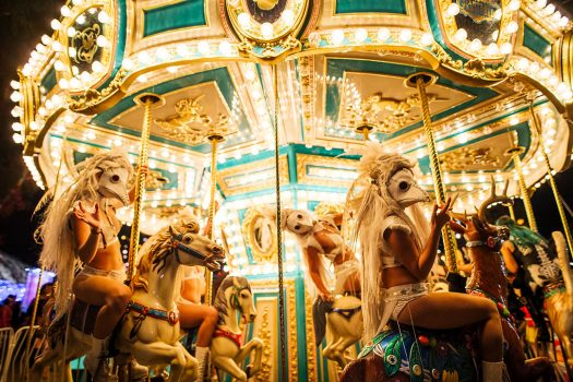 Masked performers on the carousel
