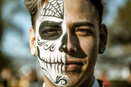 A Headliner in Day of the Dead–inspired makeup