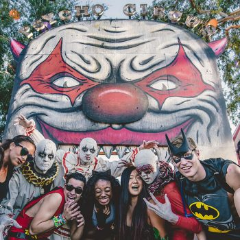 Creepy performers frighten a group of Headliners