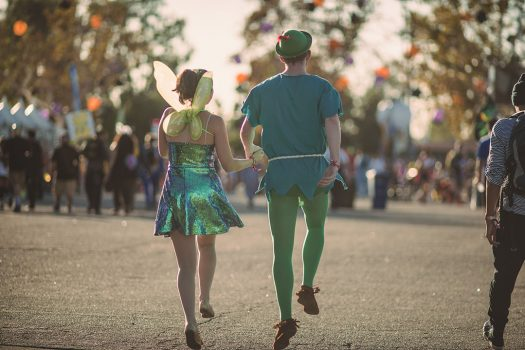 Peter Pan and Tinkerbell skipping