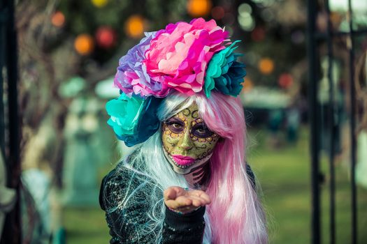 A performer in a Day of the Dead–inspired costume
